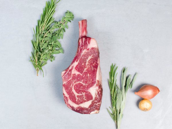 DRY AGED BONE-IN RIBEYE STEAK, OUR SIGNATURE WAGYU — Shop by ounce, one bone-in steak, 30-day aged