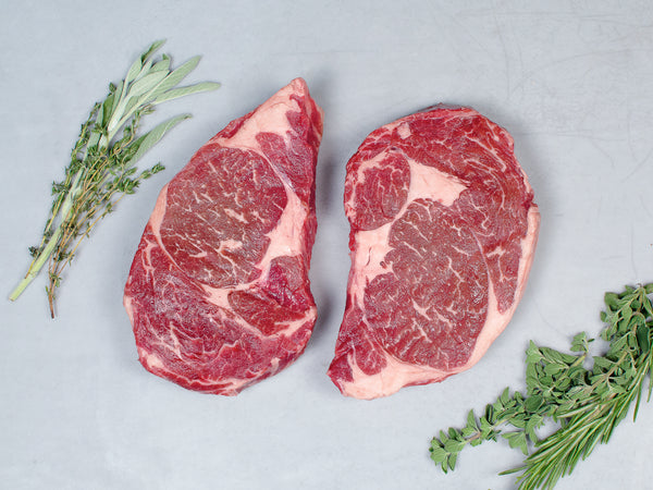 STEAKS AND BACON, Two 14-16 oz Wagyu ribeye steaks and 1lb pack Signature bacon
