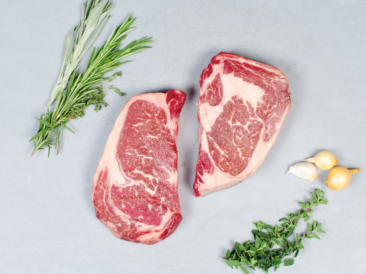 STEAKS AND PORK CHOPS, Two Berkshire porterhouse pork chops and two 14-16 oz Wagyu ribeye steaks