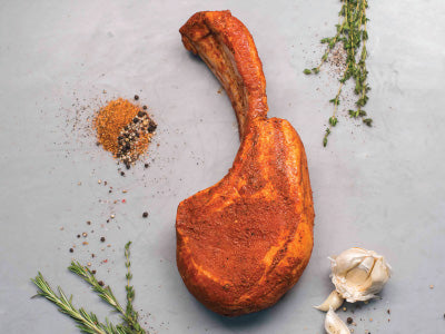 THE BBQ COWBOY PORK CHOP! Our largest double-cut, long-bone 28 oz Berkshire pork chop pre-seasoned with Tempesta's phenomenal BBQ rub