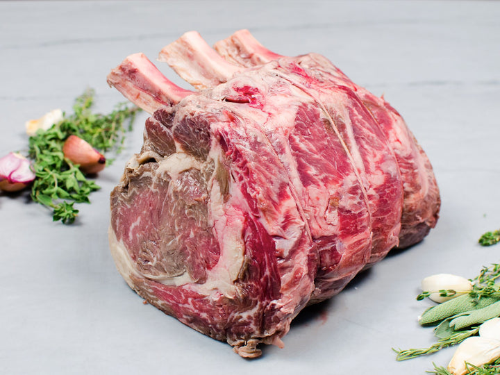 "STANDING RIB ""COWBOY"" BACON ROAST — Wagyu — a majestic bone-in roast lined with heritage bacon"