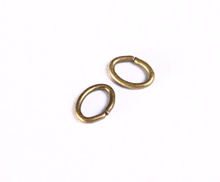 5mm Petite antique brass jumpring - oval jumpring - open jumpring - 50 pieces (993)