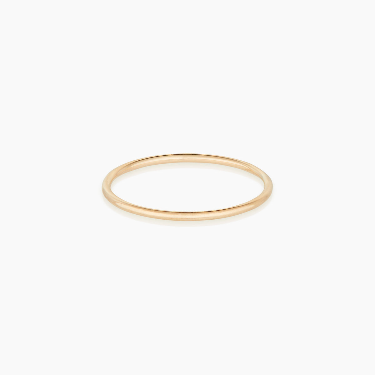 Image of delicate solid gold ring