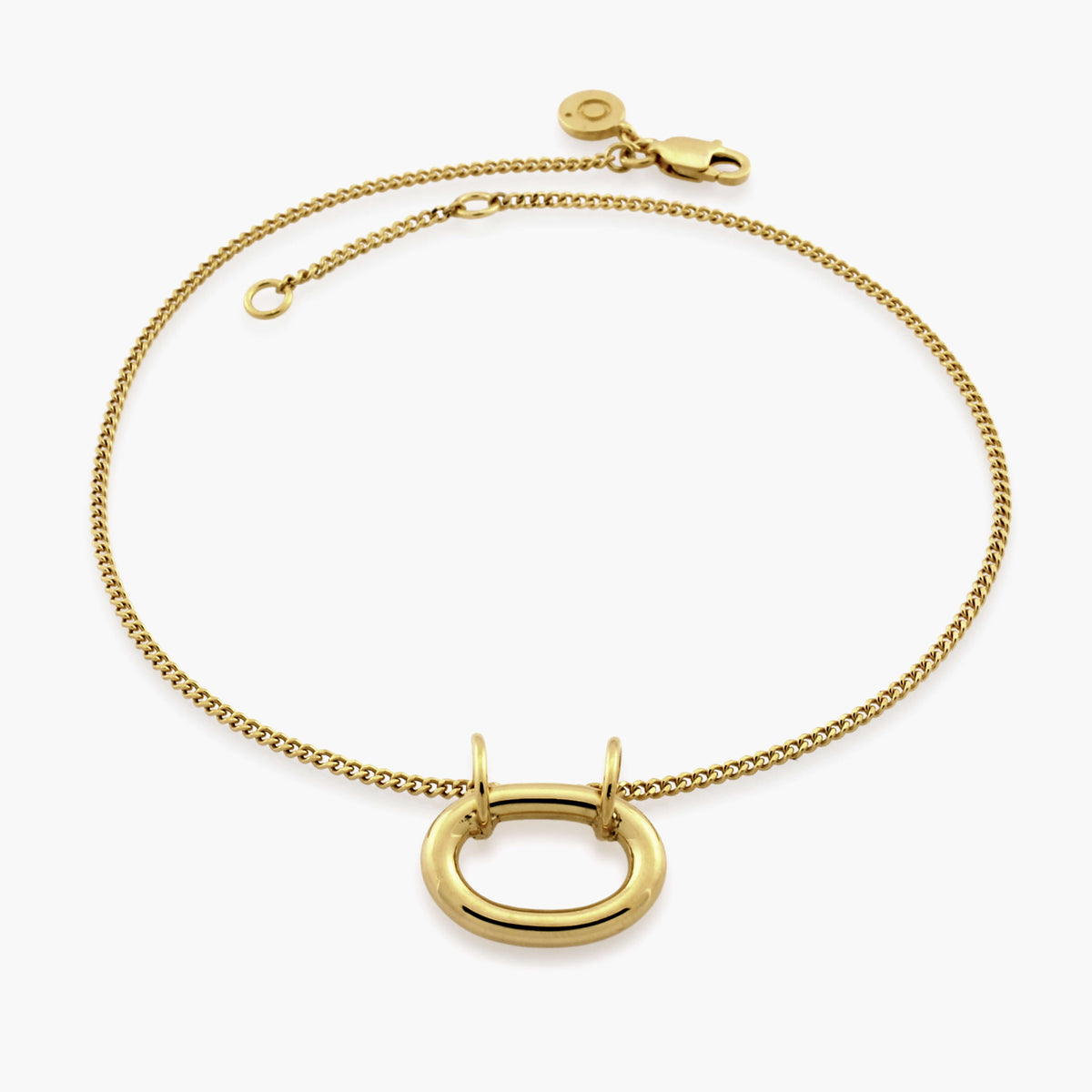 A beautiful gold anklet with a gold oval pendant