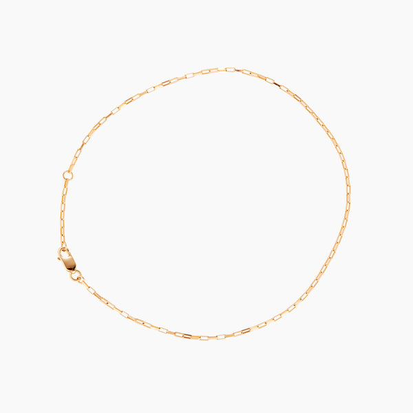 A gold chain anklet with an extension, as part of the new otiumberg collection.