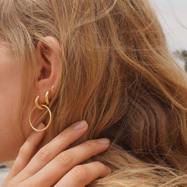 The gold duo hoop as part of the Taylr Anne x Otiumberg Collection. Sold as single.