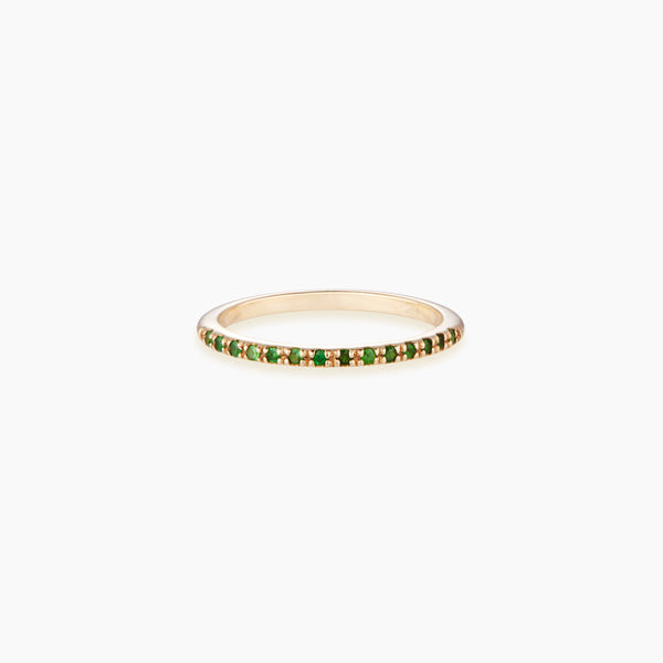 A beautiful half eternity ring paved with Tsavorites