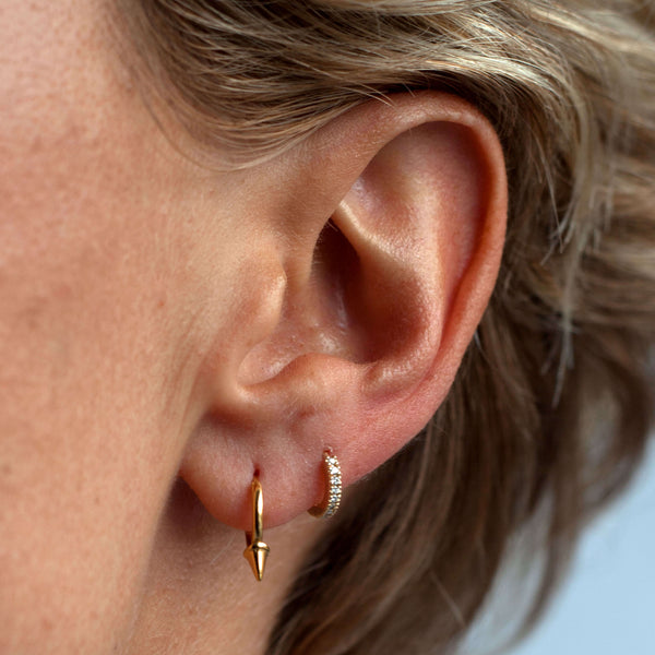Tiny Spike Gold Hoops part of the Otiumberg Collection.