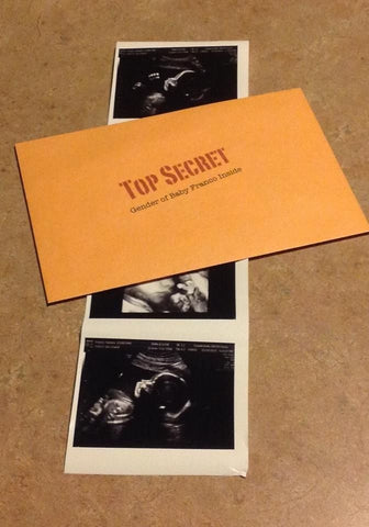 "An envelope with the words ""top secret gender of baby franco inside."""