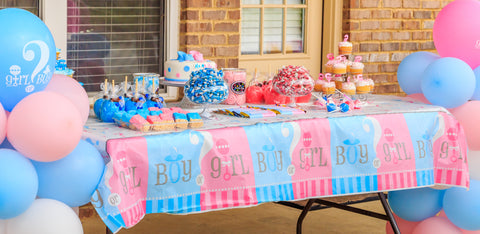 Table covered with gender reveal themed food.