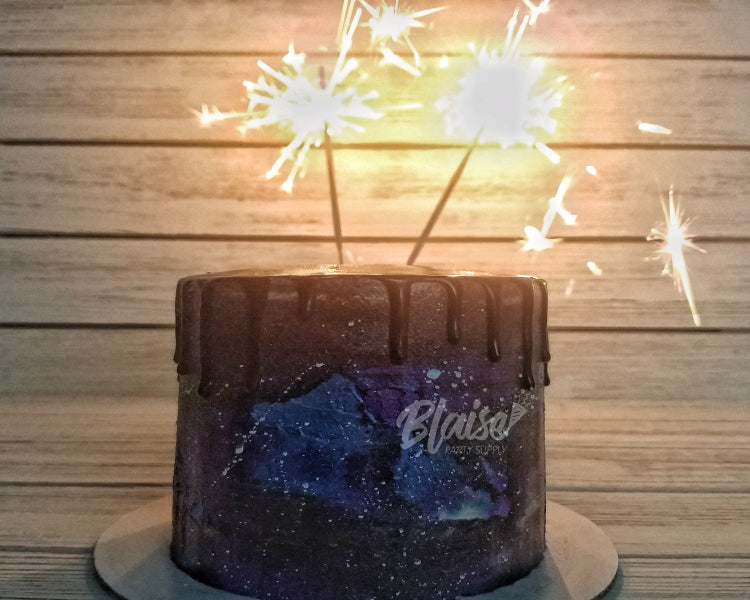 Birthday cake with beautiful 10 inch sparklers burning gold sparks