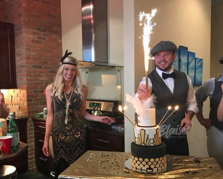 Guests celebrate a friend's birthday with a shower of golden sparks from our 6 inch cake top sparklers