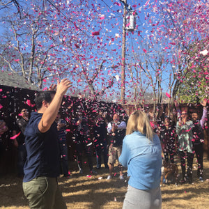 This Mom and Dad to be had the perfect way to announce the baby to be's gender with a stunning burst of pink confetti cannons