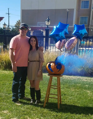 This couple revealed they are having a boy by using our blue gender reveal smoke bomb inside of a pumpkin