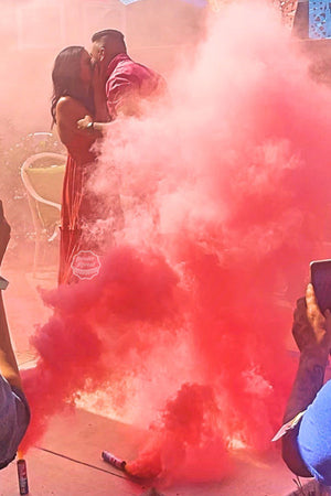 These parents to be are completely captivated by the huge cloud of smoke given by our pink gender reveal smoke bombs