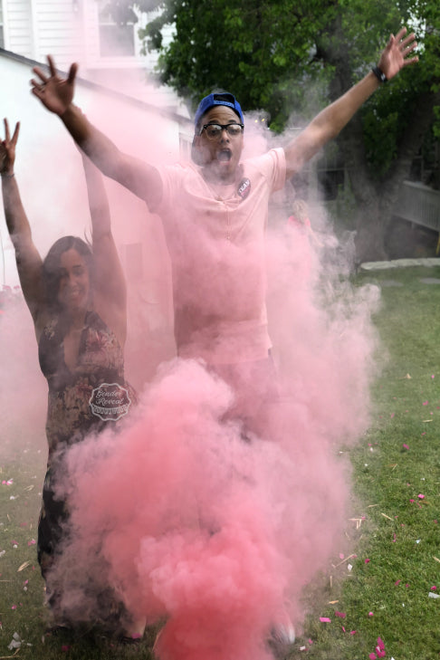 It's a girl!!! These parents to be celebrate in this mesmerizing cloud of smoke that our pink gender reveal smoke bombs gives off when lit