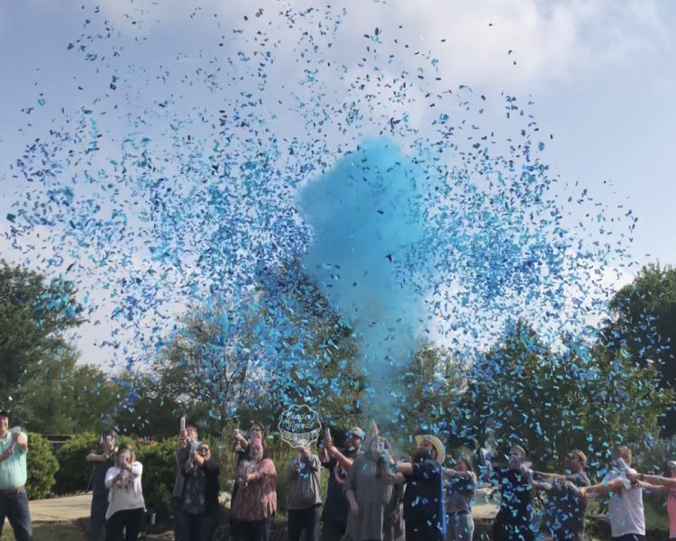 Family and Friends cover the sky using powder and confetti mixture cannons as they reveal the gender of the baby