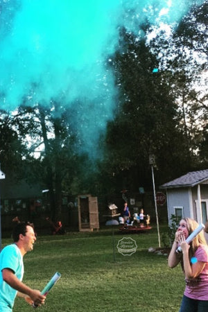 These parents to be are elated to find out they are having a boy by using our blue powder cannons