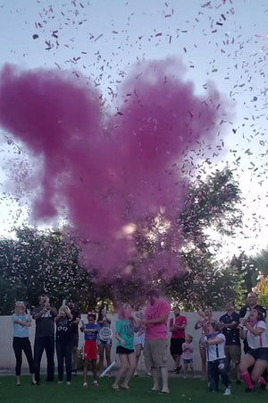 The parents to be were amazed by our pink gender reveal and powder cannon that was popped high above their heads