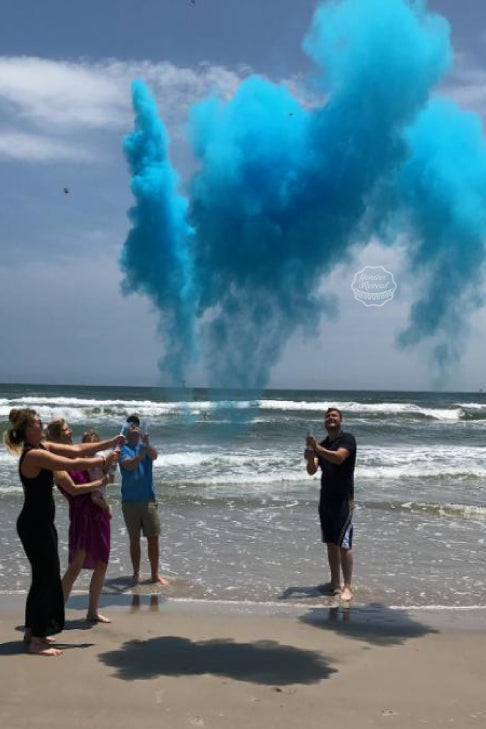 This couple had a beautiful beach gender reveal using our blue powder cannons