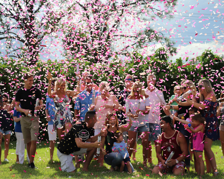 These parents to be were completely covered in dark pink and light pink gender reveal confetti