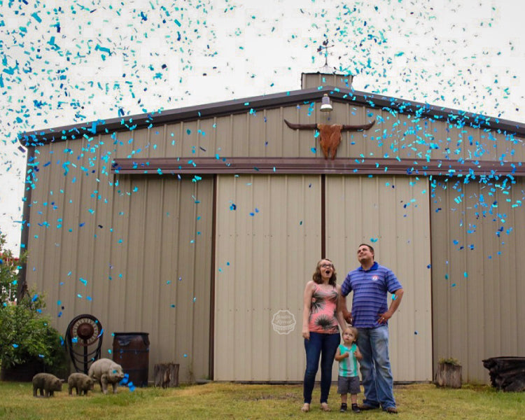 It's another boy! This family is taking in that moment as they are showered with blue confetti cannons
