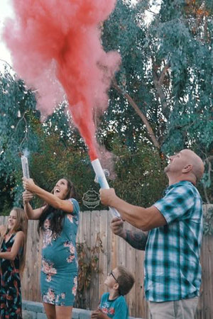 This family announced they are having a girl by using our pink gender reveal powder cannons