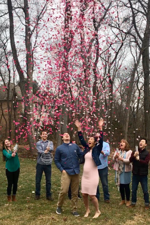 Surprised with our pink confetti cannons, these parents to be are having a girl