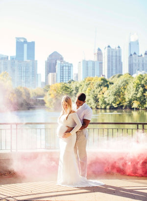 Pink gender reveal smoke bombs girl