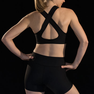 Marena Sport style 104 compression sports bra with criss-cross straps, back view in black