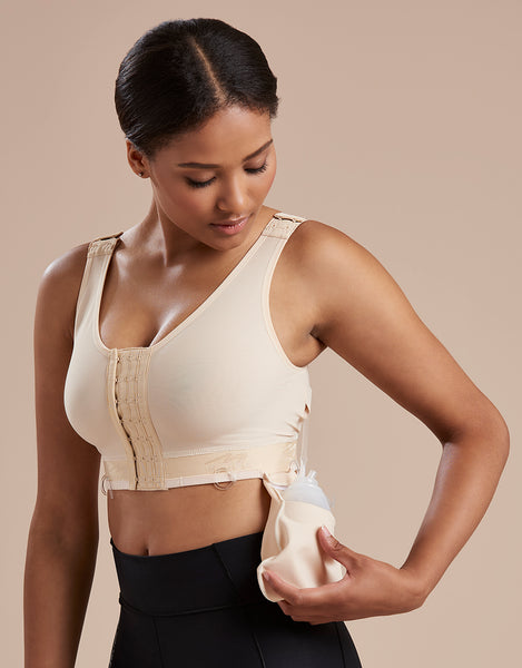 Marena Recovery B19 pocket bra showing the model using the drain bulb management system with a drain bulb and pouch.