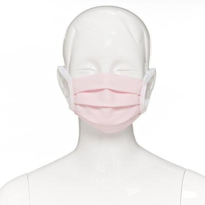 Child face mask , 2 pack , front view shown on mannequin in light pink fabric with white elastic straps