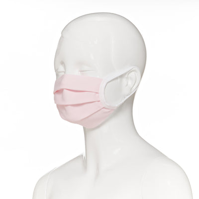 Child face mask , 4 pack , side view shown on mannequin in light pink fabric with white elastic straps