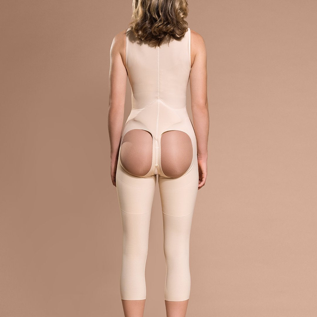 Marena Recovery style FBOM calf-length open-buttock compression girdle, back view in beige showing sacral pad and open buttock.
