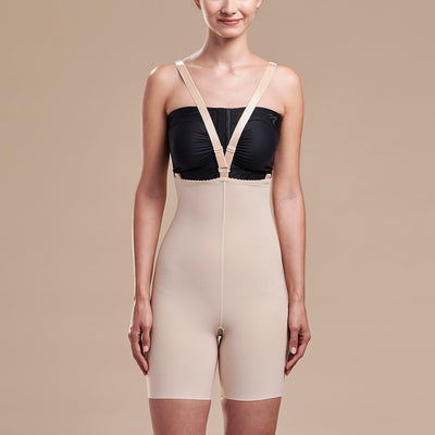 Marena Recovery style FBT2 mid thigh length compression girdle with suspenders, front view in beige shown with crossing straps
