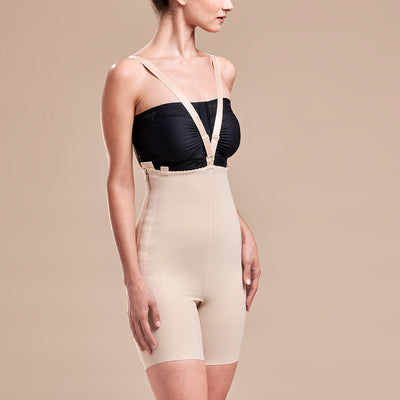 Marena Recovery style FBT compression girdle with suspenders thigh length, side view with crossing straps in beige