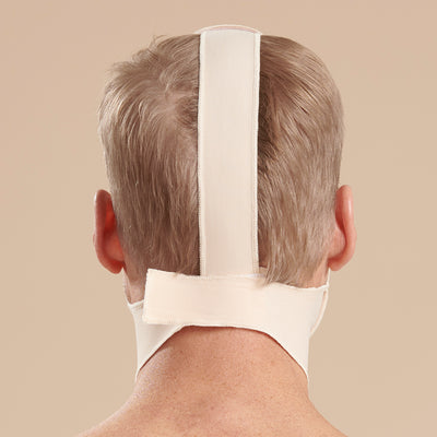 Marena Recovery style FM100-B minimal coverage, mid neck length compression face mask, back view in beige shown on male model.