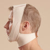 Marena Recovery style FM100-B minimal coverage, mid neck length compression face mask, side view in beige shown on male model.