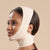 Marena Recovery style FM100-B minimal coverage, mid neck length compression face mask, side view in beige shown on female model.