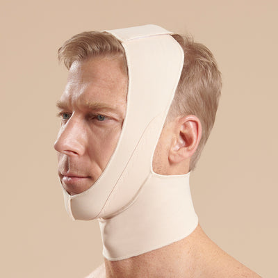 Marena Recovery style FM100-C minimal coverage, full neck length compression face mask side view in beige shown on male model