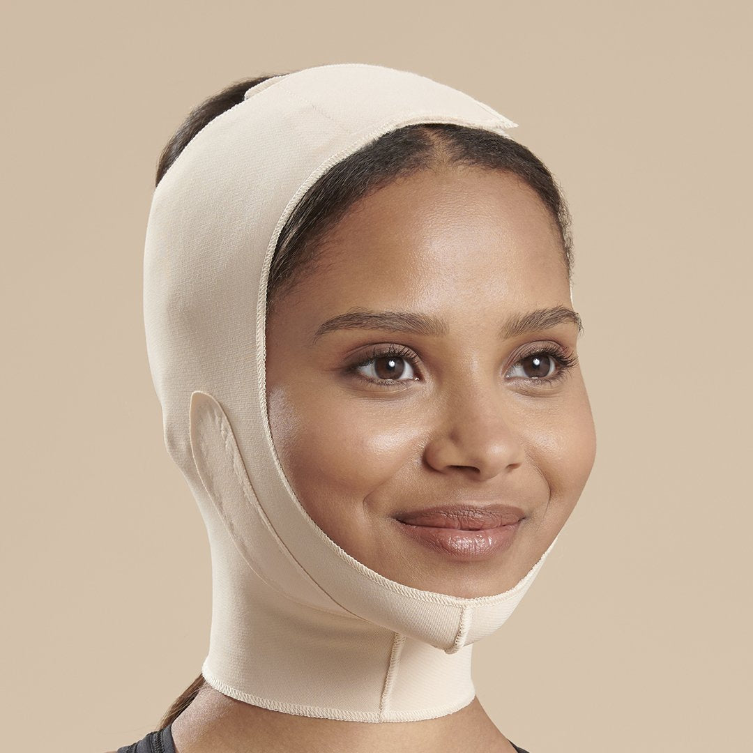 Marena Recovery FM300-B compression face mask side view in beige showing top velcro closure.