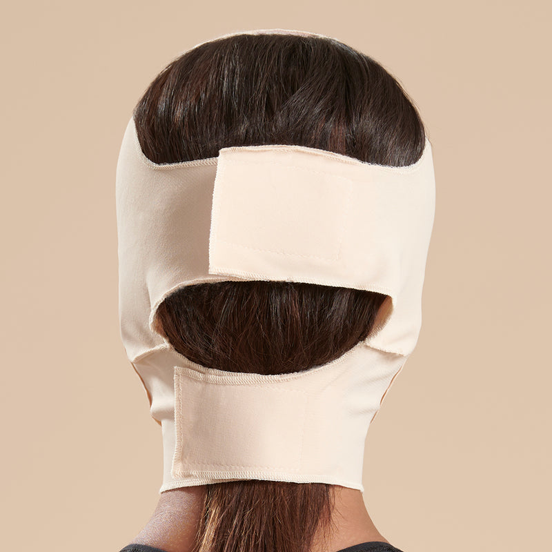 Marena Recovery style FM300-C medium coverage, full neck length compression face mask side view in beige shown on female model