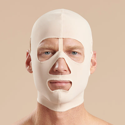 Marena Recovery style FM500 full coverage post-surgical compression face mask front view in beige, shown on male model