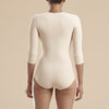 Marena Recovery style FTRA/SM Bikini length compression bodysuit with 3/4 sleeves, back view in beige