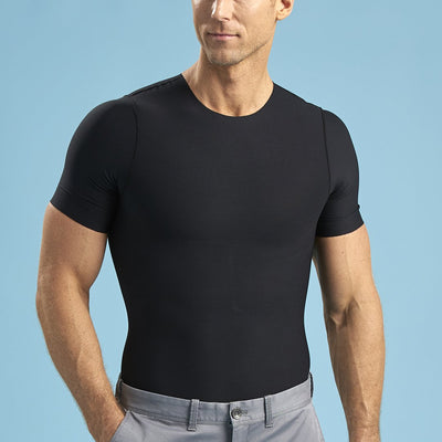 Marena Shape style ME-1000 Short sleeve compression crew neck, front view in black shown tucked into grey pants