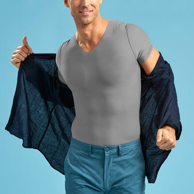 Marena Shape style ME-1001 Short sleeve compression v-neck , front pose view in grey fabric worn under navy button up shirt and blue pants