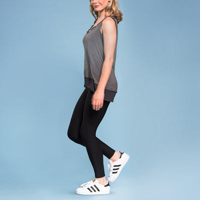 Marena Shape style ME-621 High-waist compression legging side pose, in black worn with grey tank top and sneakers