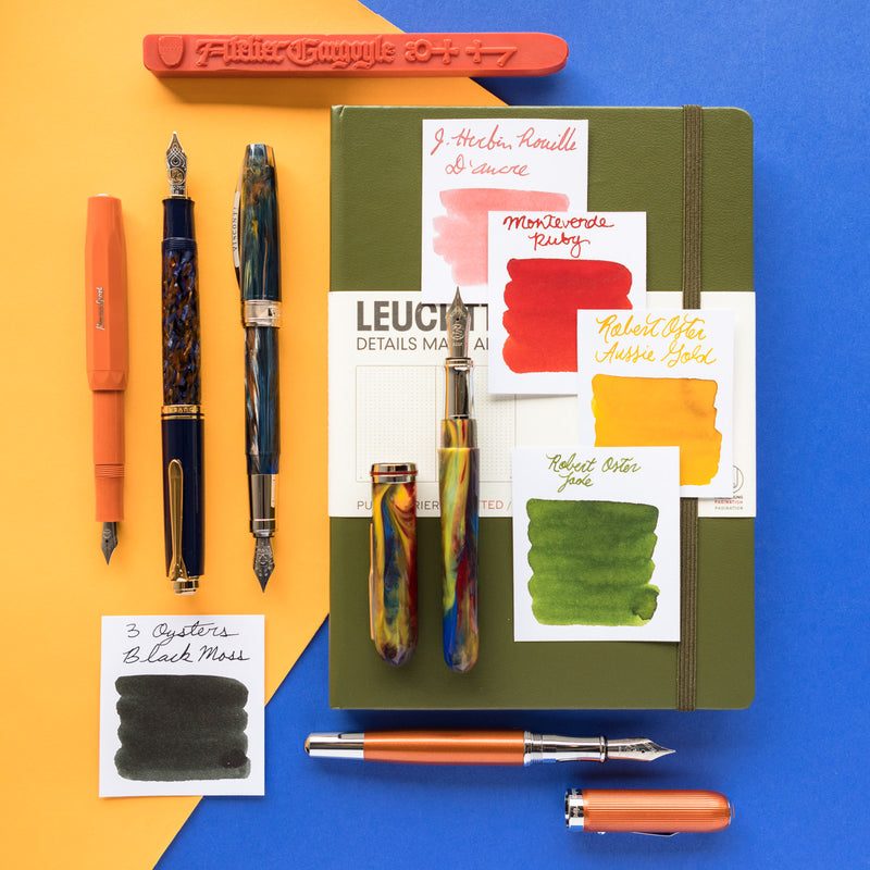 A product layout inspired by Jean-Michel Basquiat, featuring a Kaweco Skyline Sport Fountain Pen in Fox