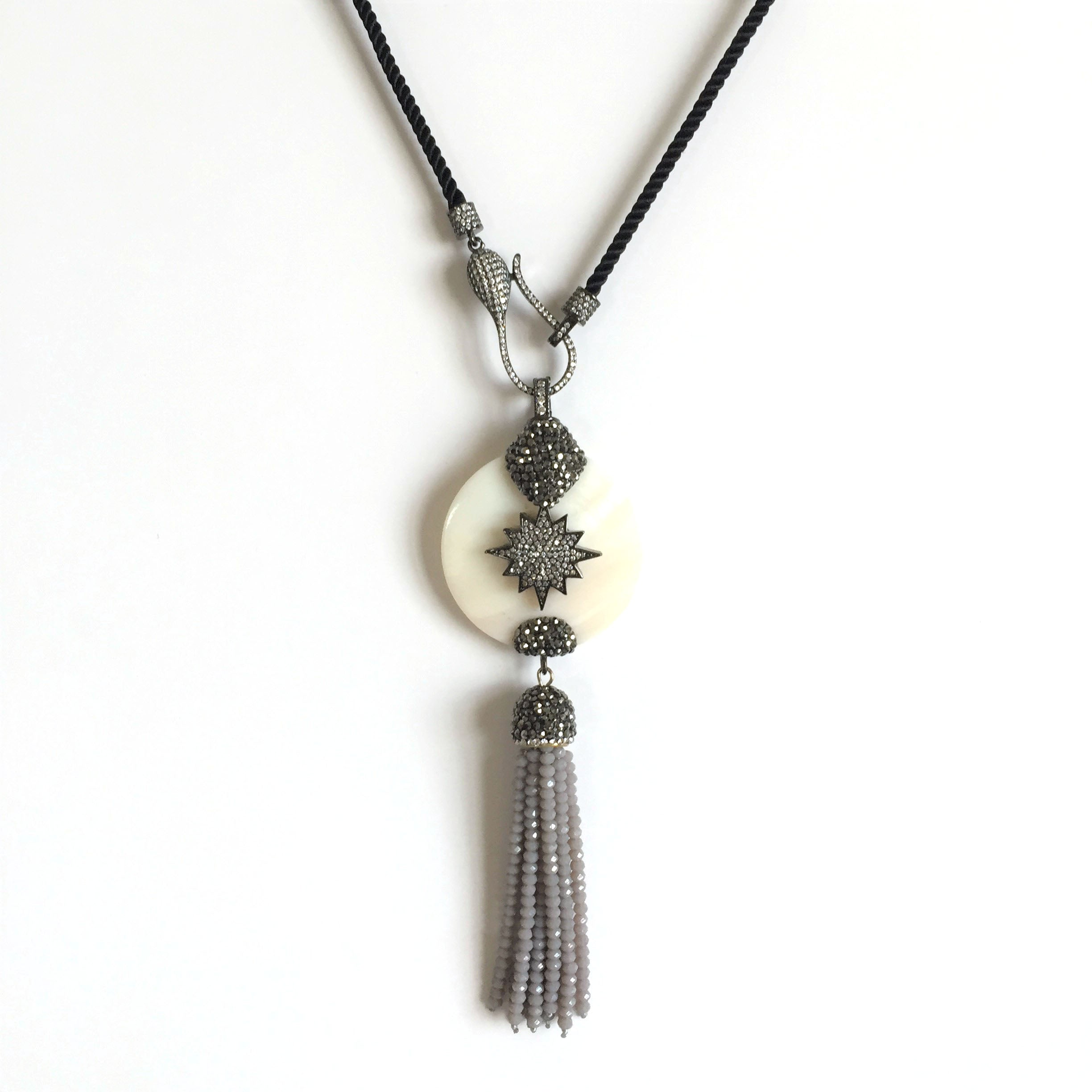 Pave Star on  Shell with Tassel Drop