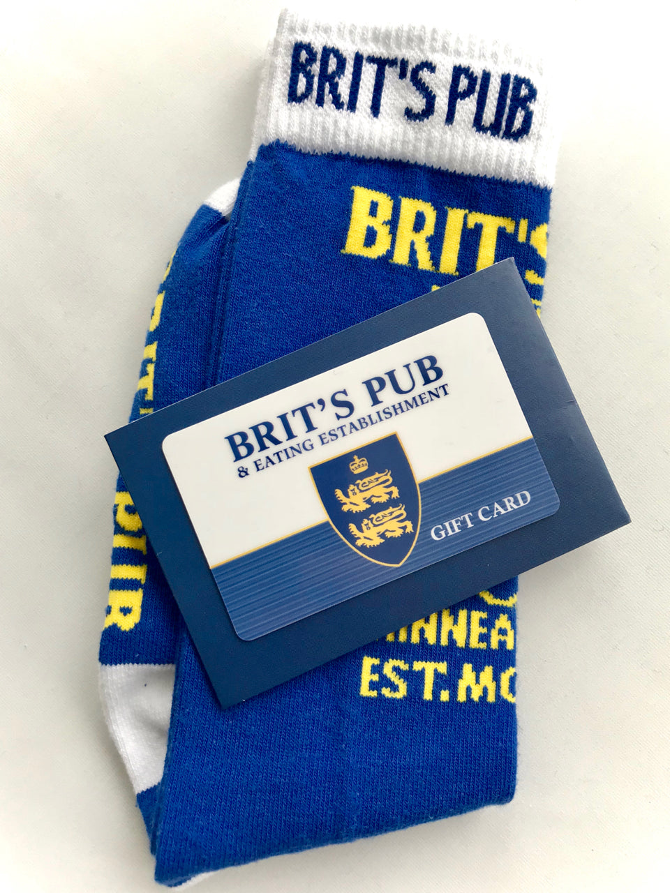 Brit's Pub Gift Card with a pair of Brit's Pub Dress Blues.